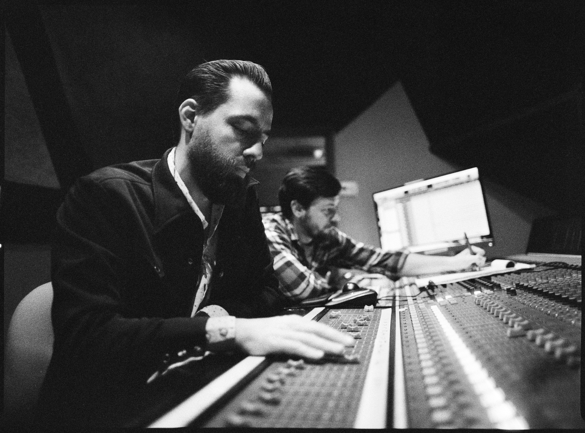 Producer Matt Ross-Spang adjusting levels in the control room of Sam Phillips Recording in Memphis, TN