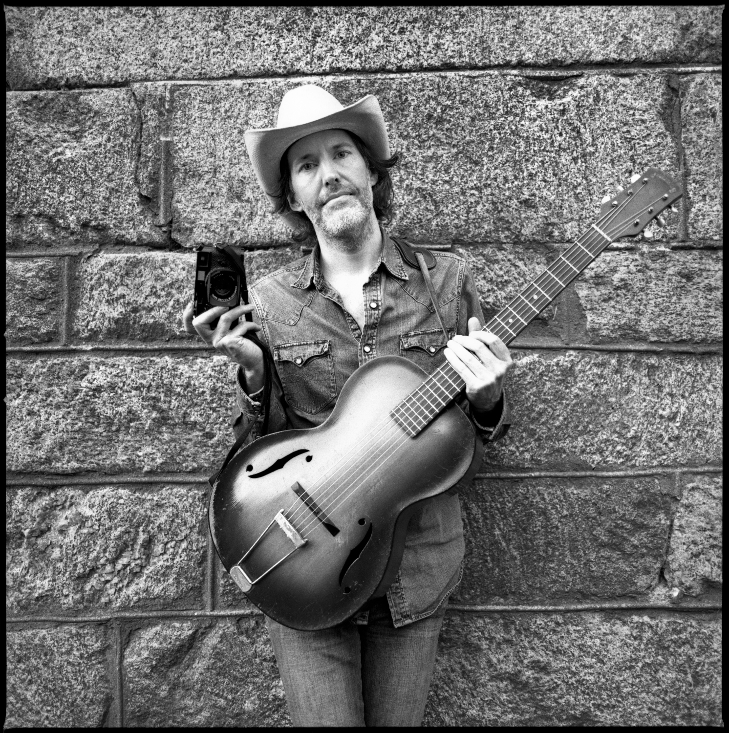 Dave Rawlings and his Leica camera at Newport Folk Fest