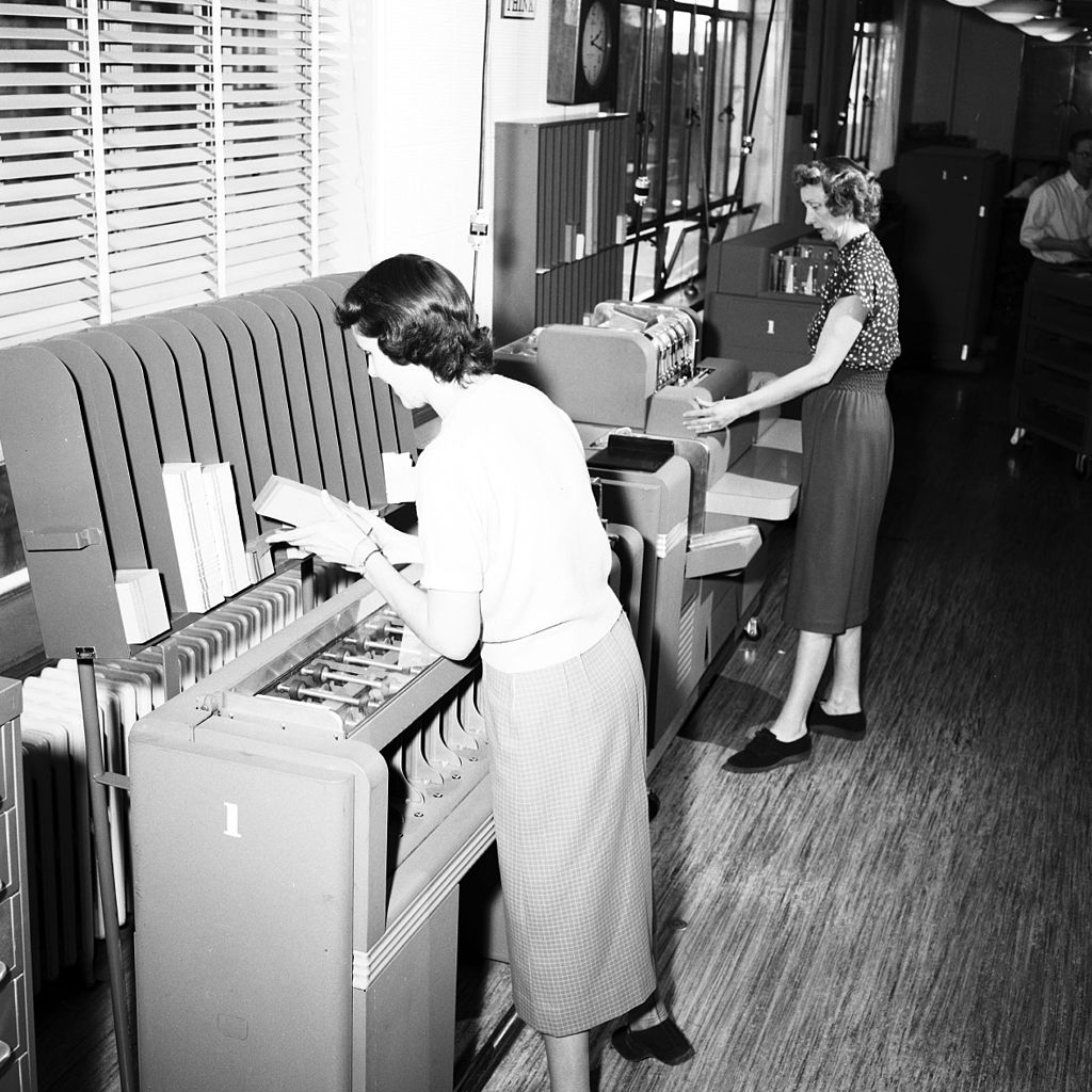 by Seattle Municipal Archives from Seattle, WA (women working in City Light office, 1954) [CC BY 2.0 (http://creativecommons.org/licenses/by/2.0)], via Wikimedia Commons