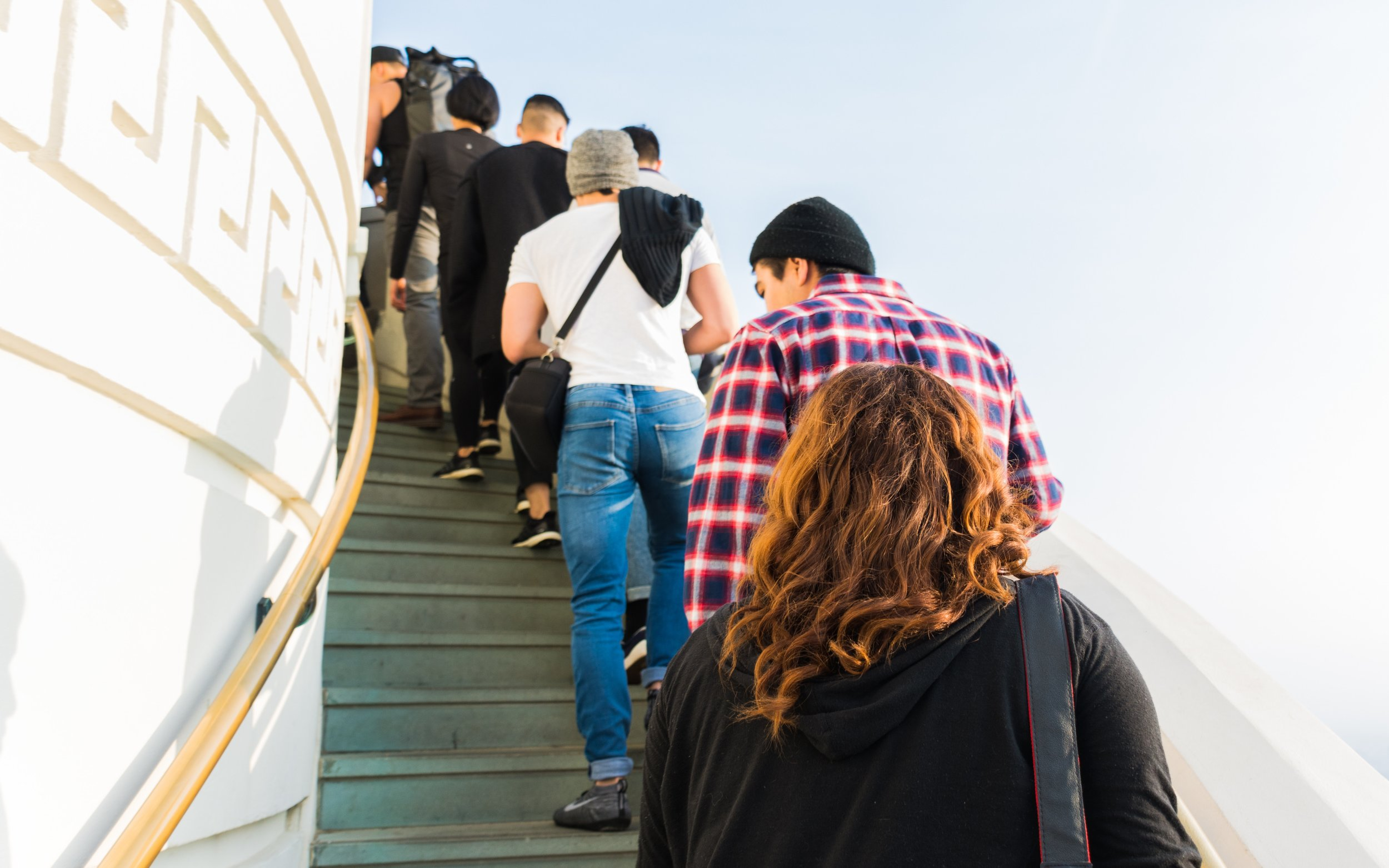 a lineup of men and women up a flight of stairs