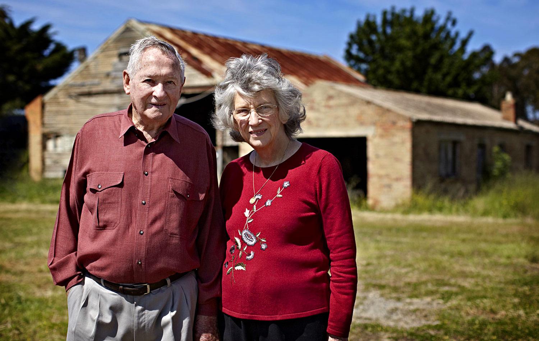 The Milburns, Dorothy and John, married for 59 years, retired Keilor Market Gardeners, in front of the original barn john's Grandfather built in Keilor.