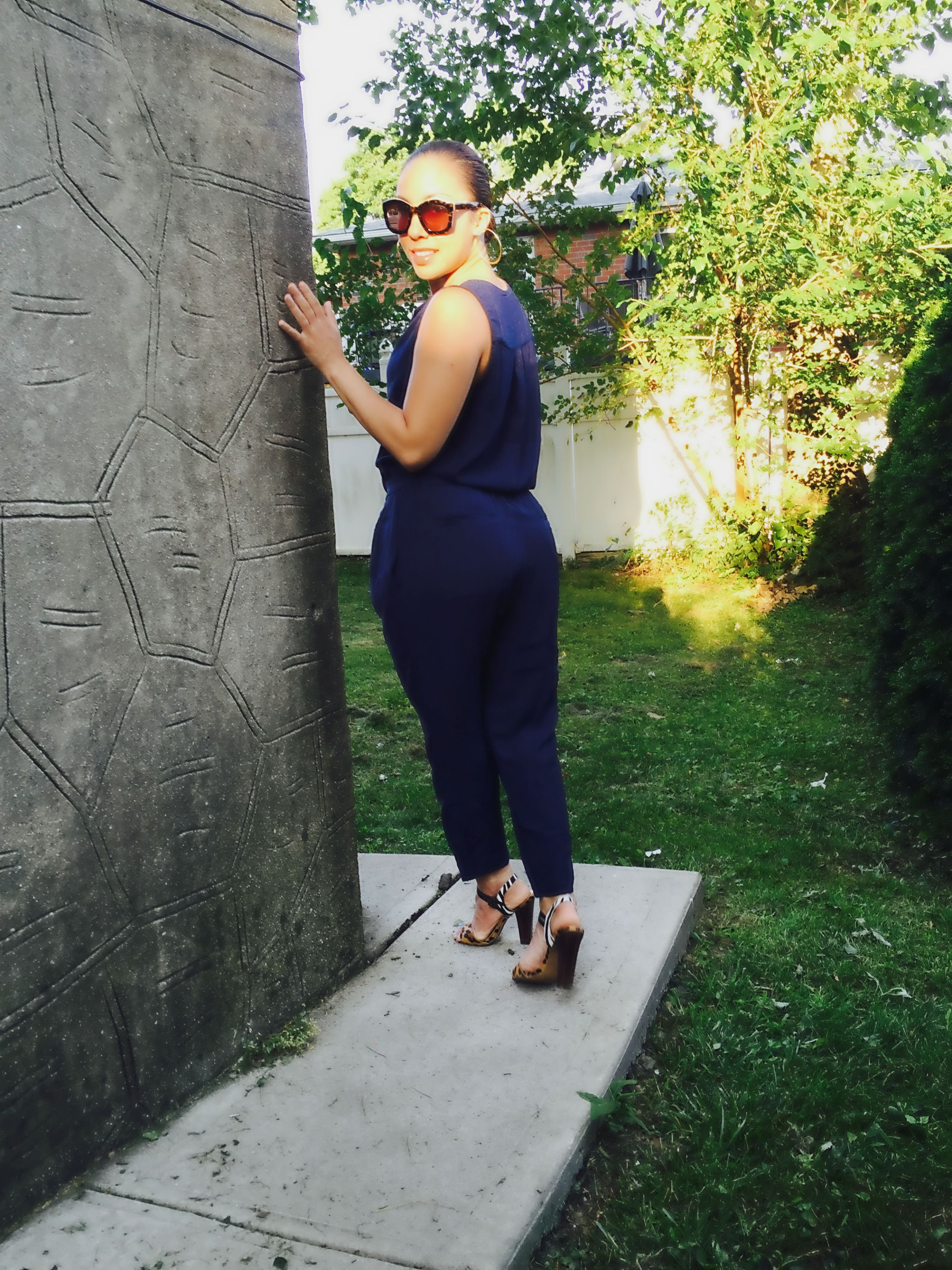 Herringbone Crepe Jumpsuit  (available in the color pale mauve)  |  Heels  | Le Spec Sunglasses (similar  here ) | Earrings