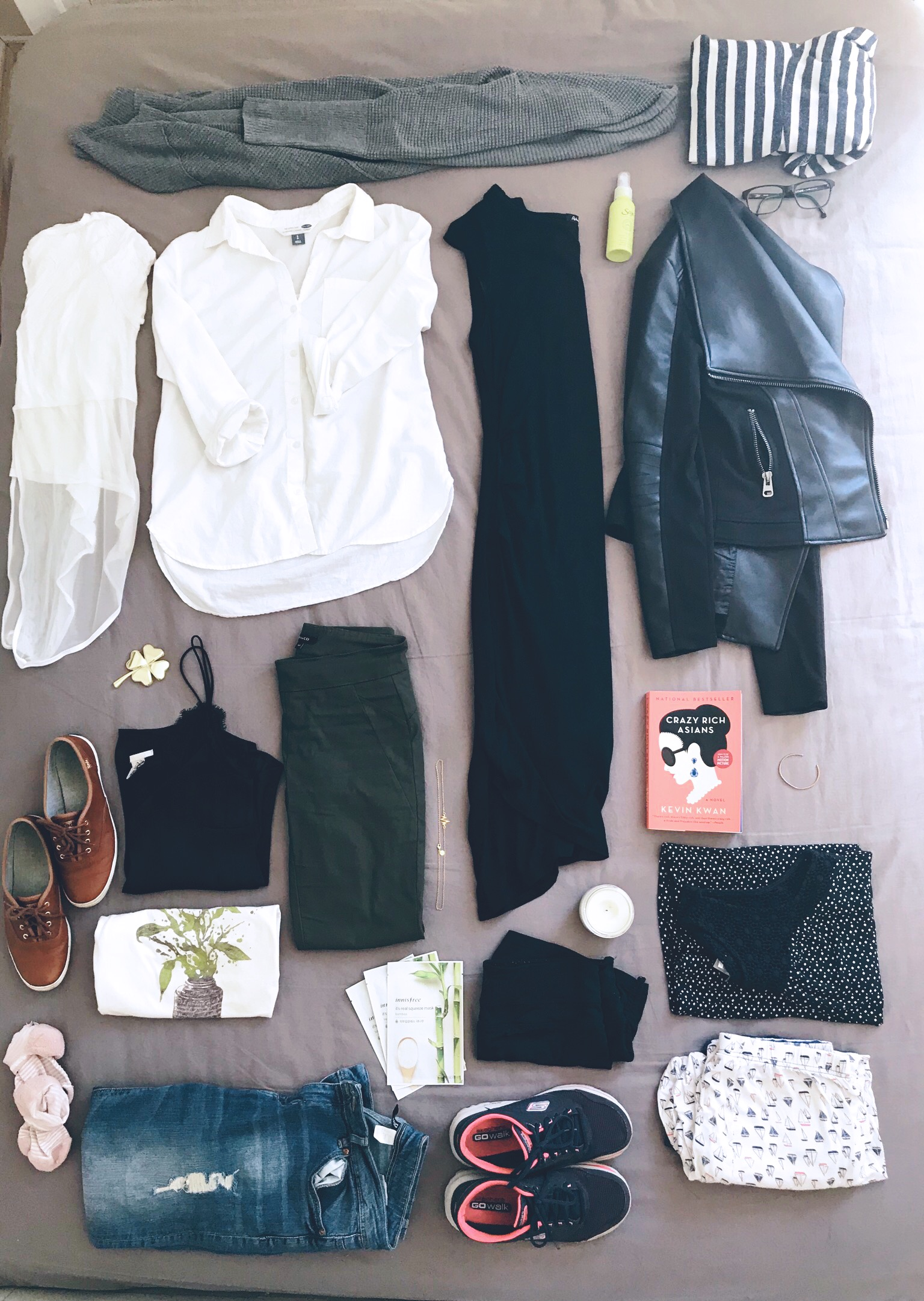 Top Centre - Clockwise:  Grey Sweater wrap  |  Bootlegger,   Striped Hoodie sweater |  Bluenotes, Zap Toner   | Saje,   Black Pleather Jacket |  Suzie Shiers,  Black Dress  |  Reitmens,   Crazy Rich Asians by Kevin Kwan   | Chapters,   Blue tank top  | Second hand on a road trip,  Sail boat pyjamas  | La Vie en Rose,  Candle   | Foxhound,   Black Workout shorts  | Winners,  Sketcher Runners  | Soft Moc,  Light Ripped Jeans  | H&M,  Bamboo Sheet Masks   | Innisfree ,   Pink socks  | Winners (Lemon) ,  Graphic T |  Threadless,  Brown Leather Keds |  Little Burgundy,  Black Camisole   | H&M,   Four Leaf Clover Knic Knack  | Chapters ,Green Pants   | RW&Co,   Heart Beat necklace | a gift from a bestie , White Linen Shirt   | Old Navy,   White Yoga top  | Local Yoga Store