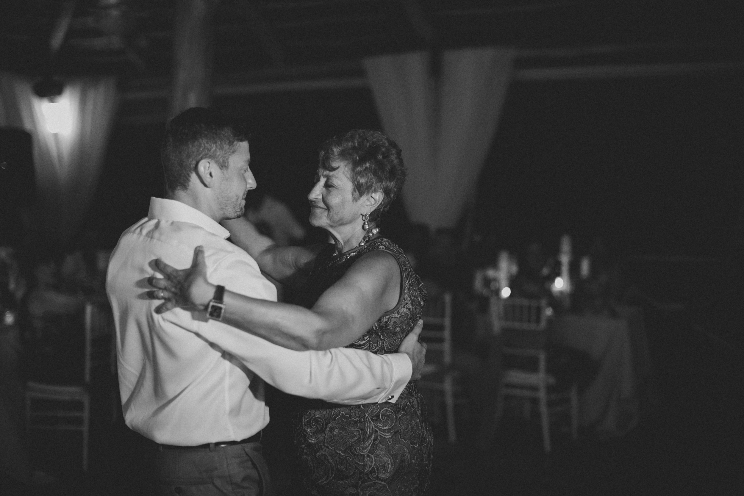 Groom and mom dancing