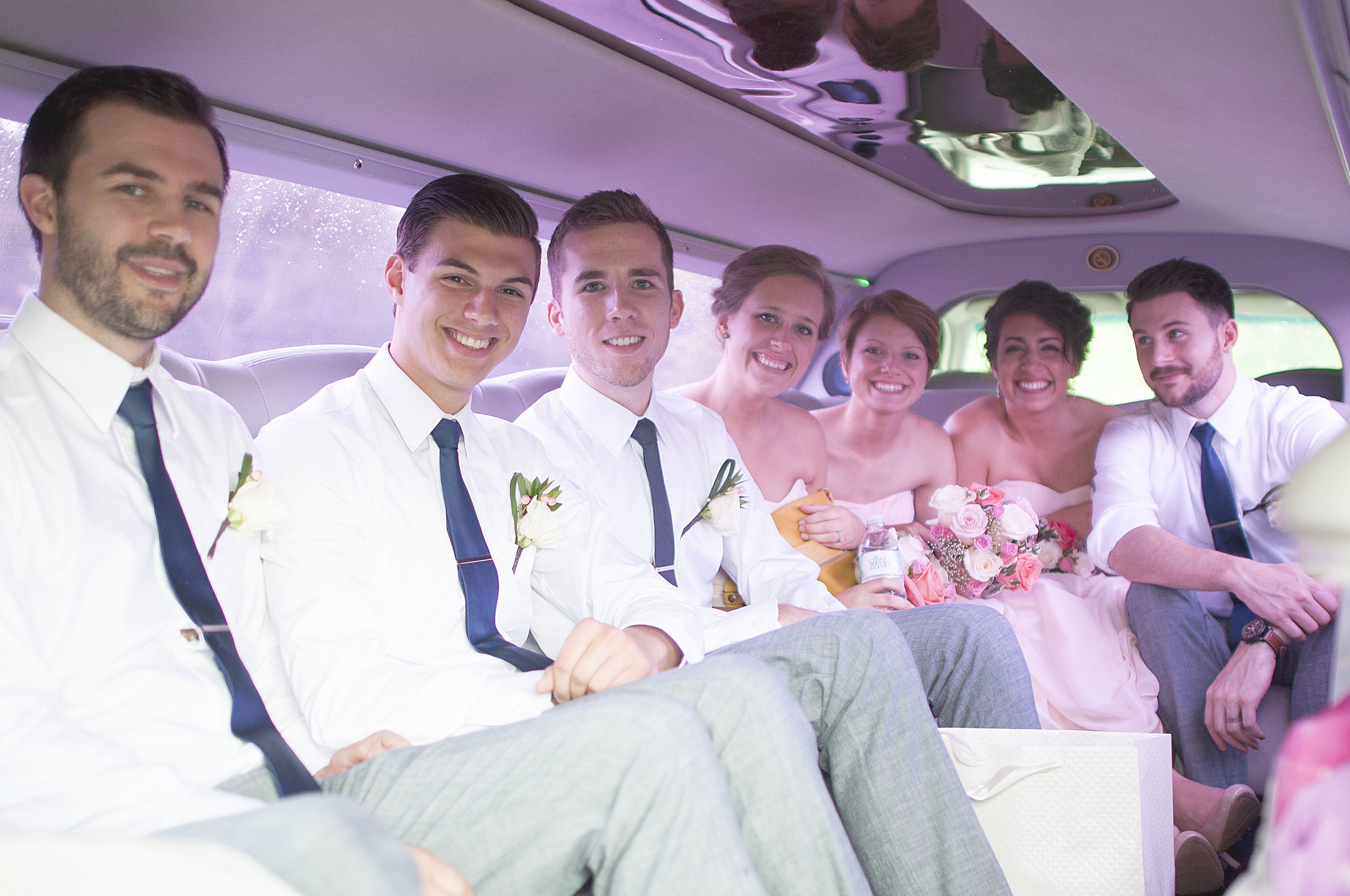 Holly was surprised with a limo ride to the reception! Unfortunately this was the point where an unexpected rainstorm begun.