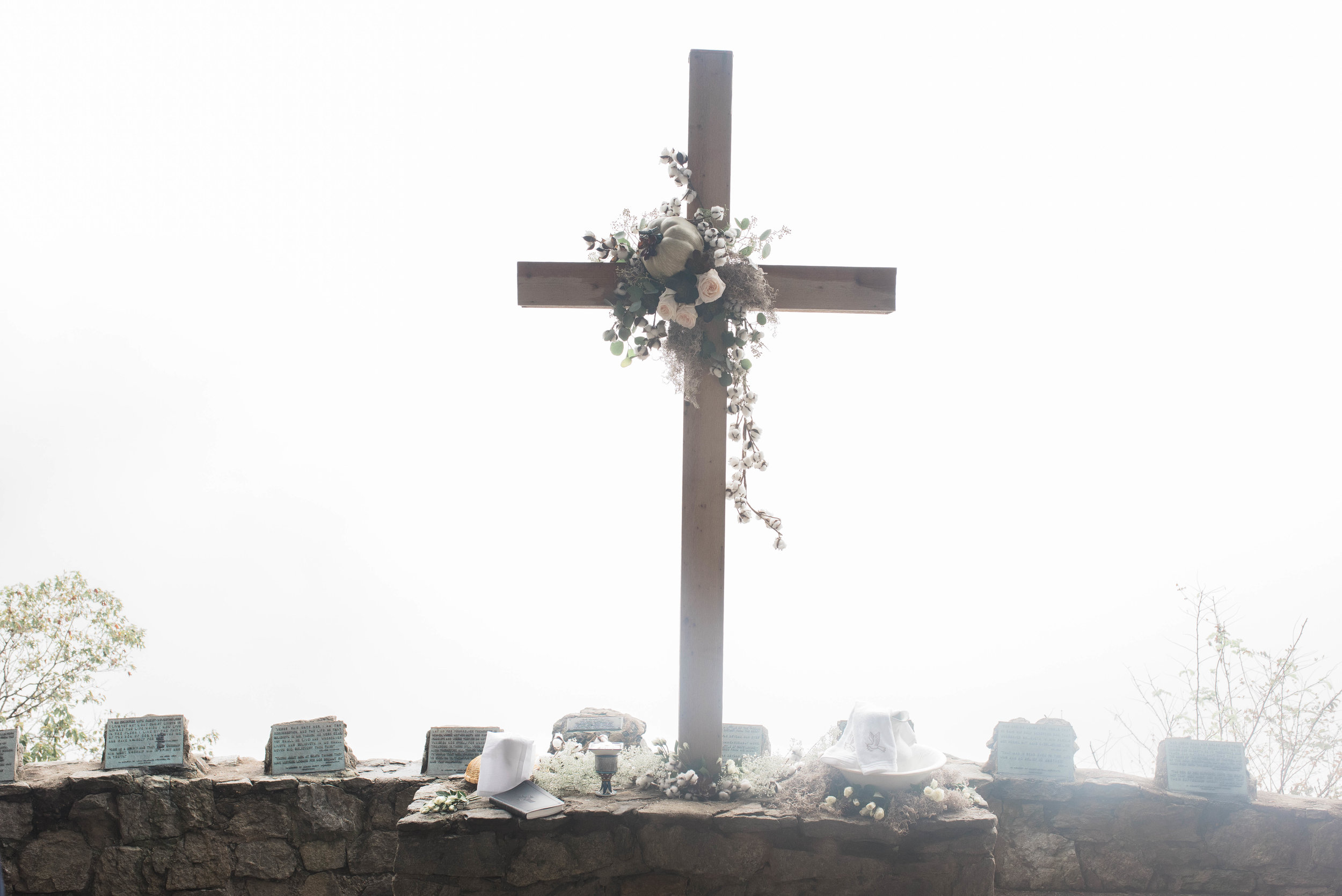 This is the overlook where you *should* be looking into the beautiful mountains, but due to the fog, could ONLY see this white wall. It ended up being the coolest thing.  Special shoutout to Margaret's aunt for putting together this gorgeous arrangement on the cross!