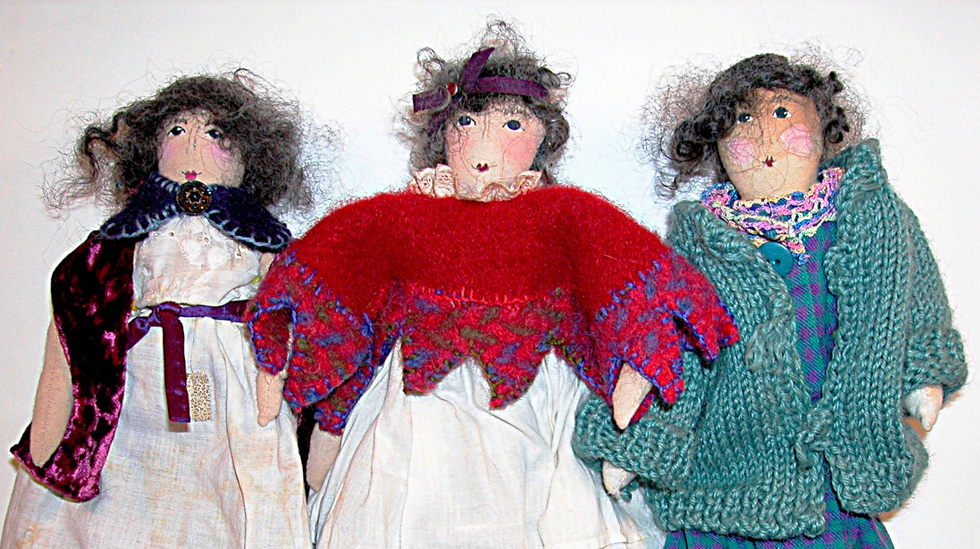 three dolls