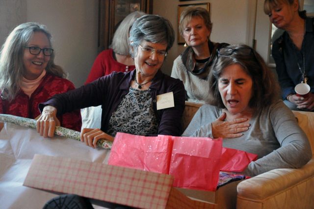 L TO R:  NANCY MOORE ,  MISSY STEVENS , AND  ELLEN SCHIFFMAN  OPENING THE GROUP GIFT.  PHOTO COURTESY  LIZ ALPERT FAY .