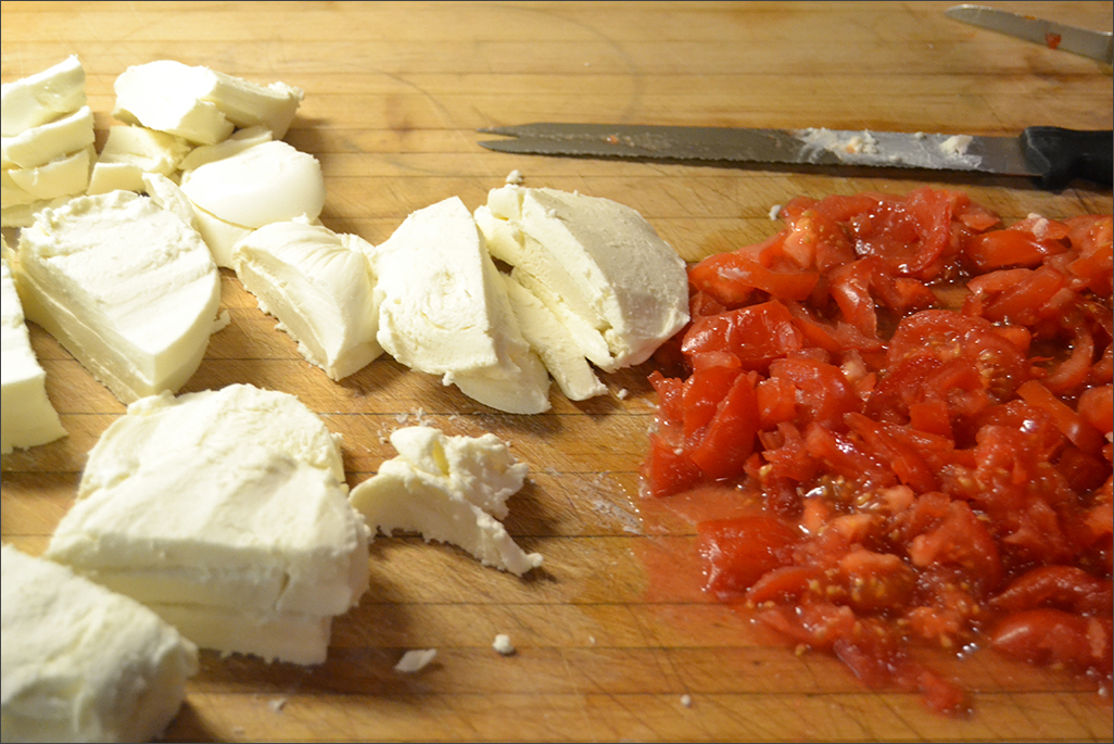 chopping tomatoes and mozzarella