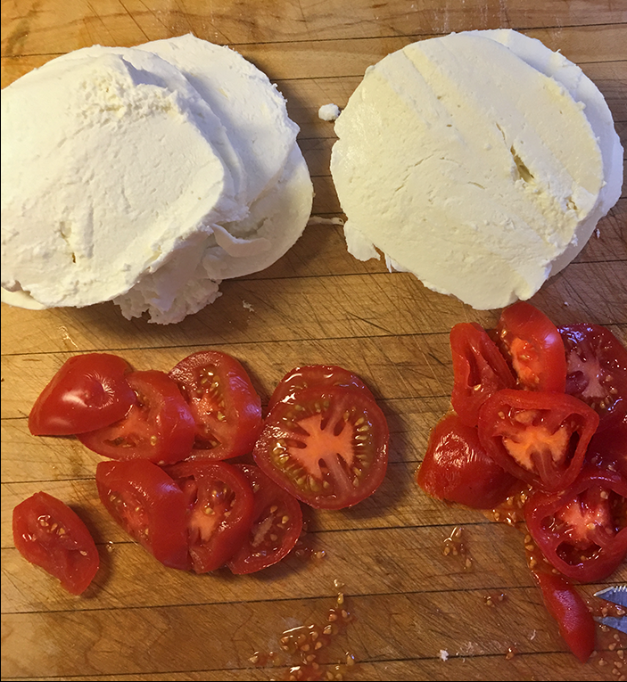 tomatoes & mozzarella on cutting board