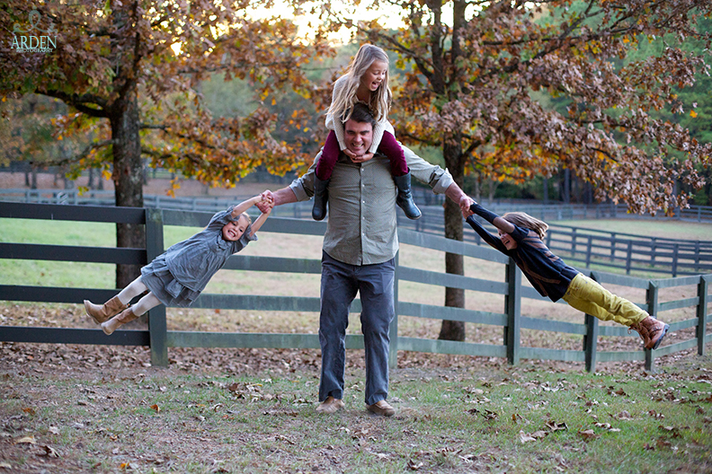 The Hill children and their father having fun at Windwood Equestrian during a Fall portrait session.