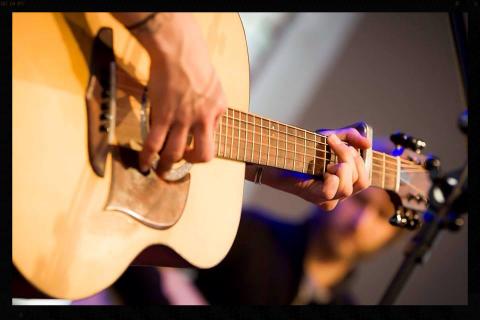 Amanda Rheaume with custom John MacDonald guitar
