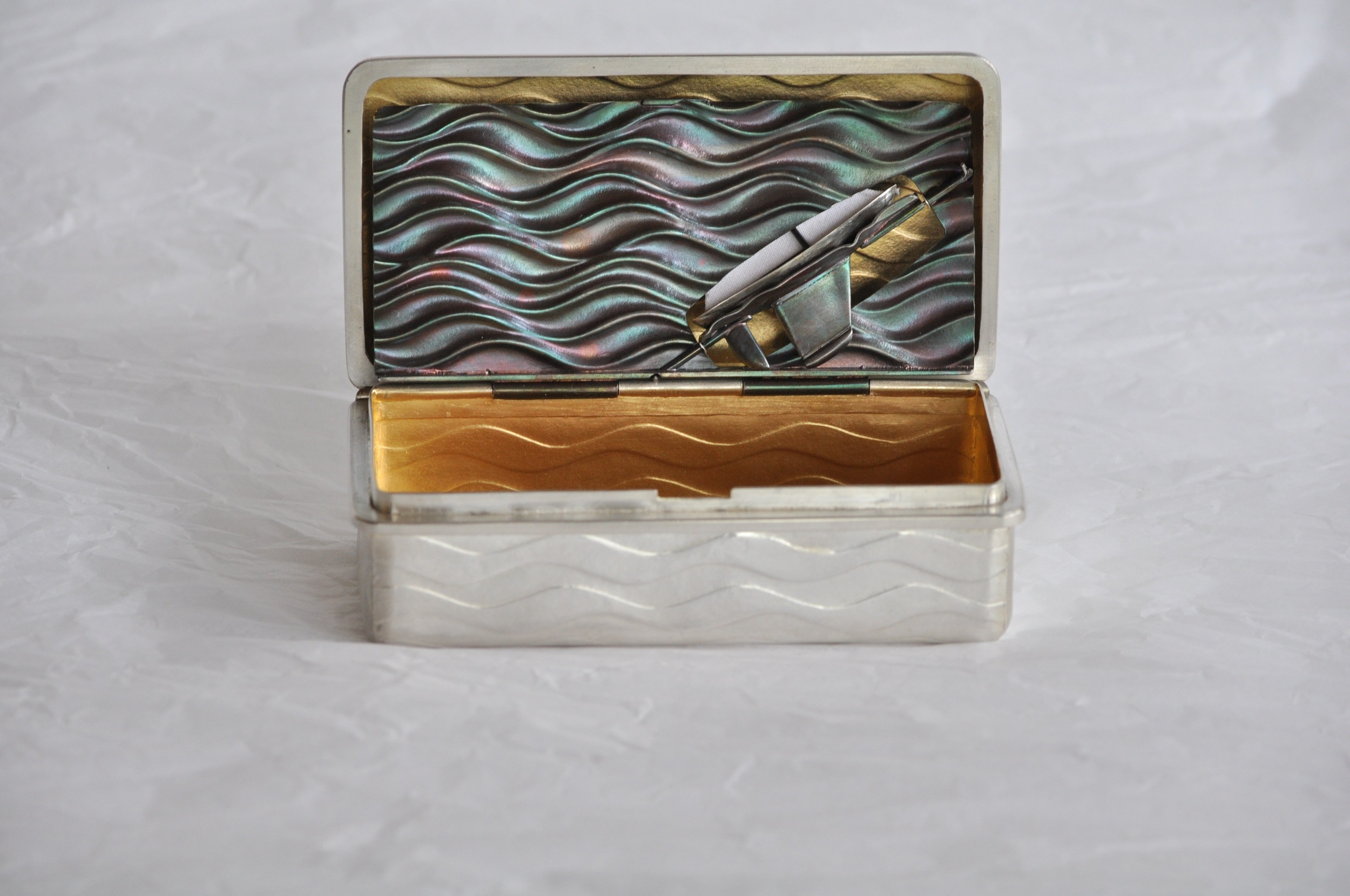 Snuffbox open inner lid up