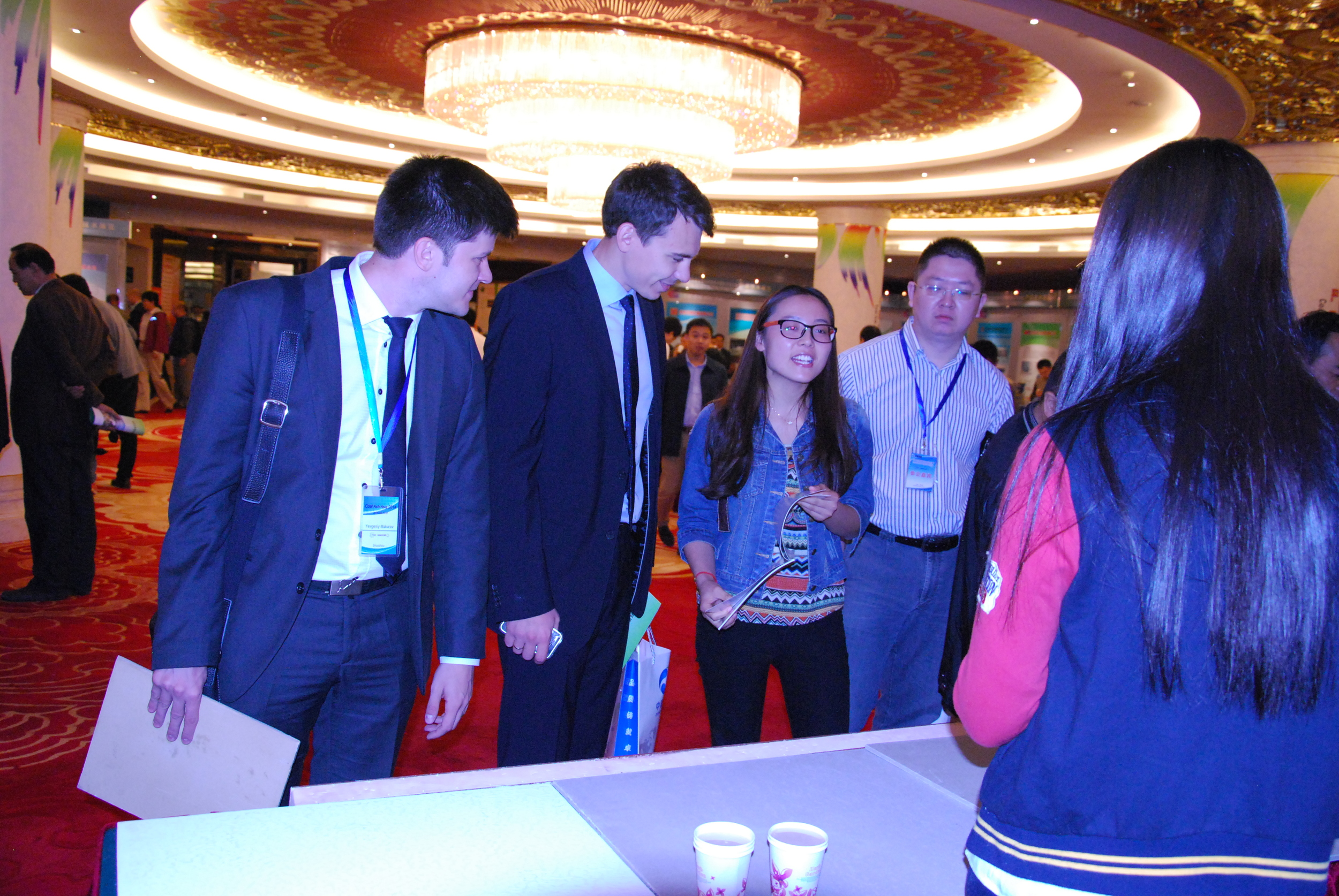 European delegates speaking with exhibitors at Coal Ash Asia 2014