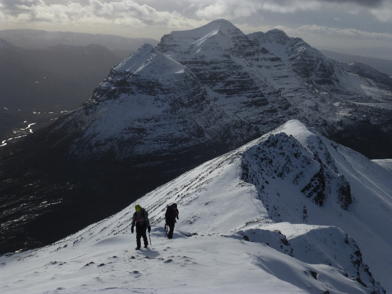 Hillwalking in March on Beinn Eighe in Torridon with Liathach behind