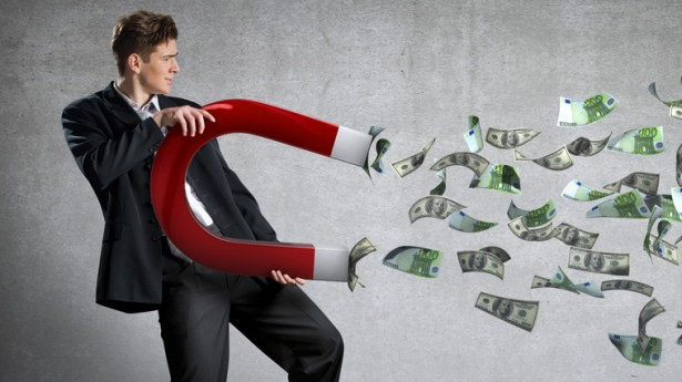 businessman-attracts-money-with-magnet-615x345.jpg