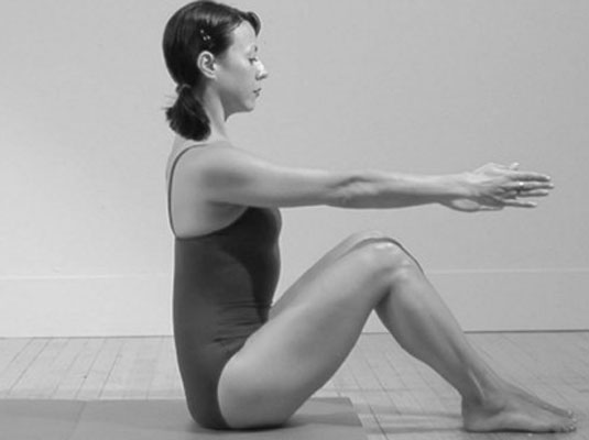 Starting position for the Pilates Roll Up/Roll Down. Notice the neutral spine. (www.mypilatesstyle.com)