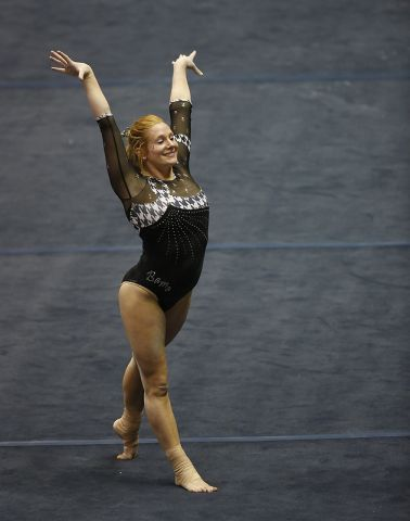 Excessive lordosis in a gymnast after finishing a routine.