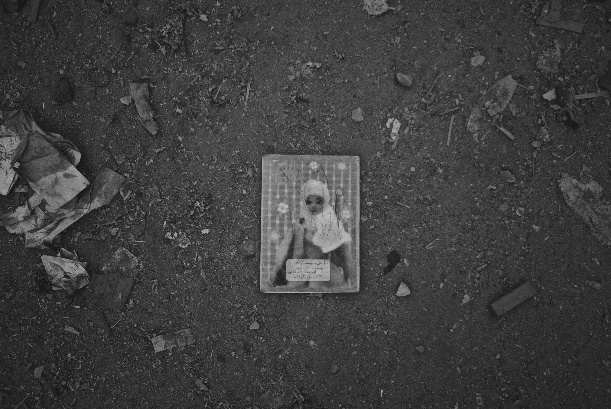 denis-bosnic-cairo-egypt-bw-photography-7-notebook-barbie-dirt-street.jpg