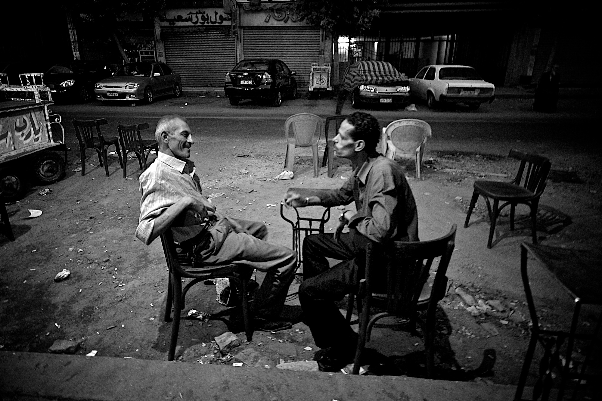 denis-bosnic-cairo-egypt-bw-photography-5-men-ahwa-talking-cigarette-trash.jpg