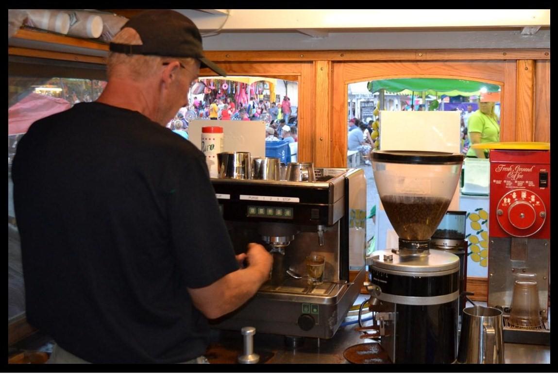 Dennis creating a latte at the 2-head espresso machine