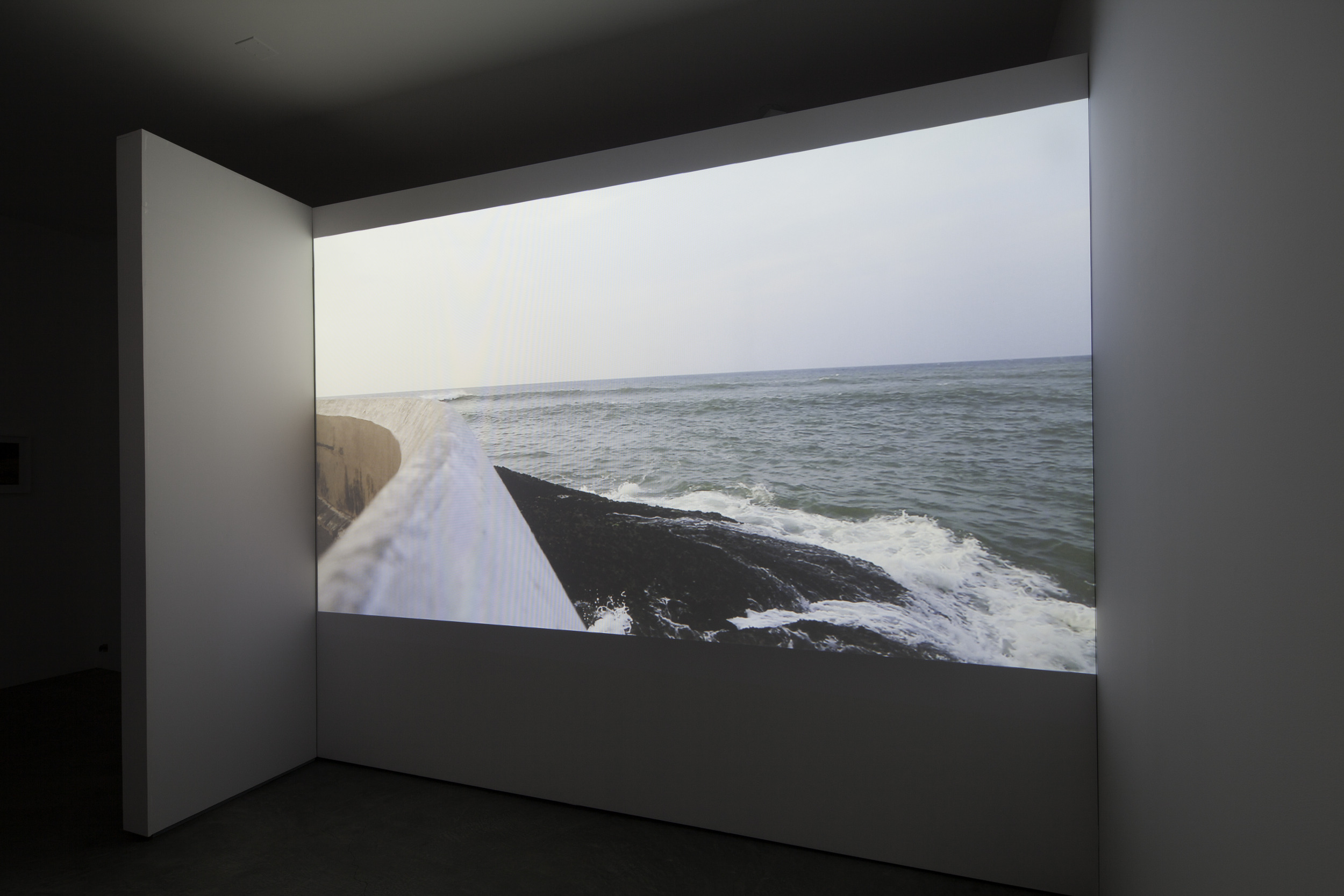 Installation view (  Shulamit Gallery, 2014)    End(s) of the World,  2013 Single Channel HD Video Projection, TRT 9:00, Looping Installation Dimensions Variable