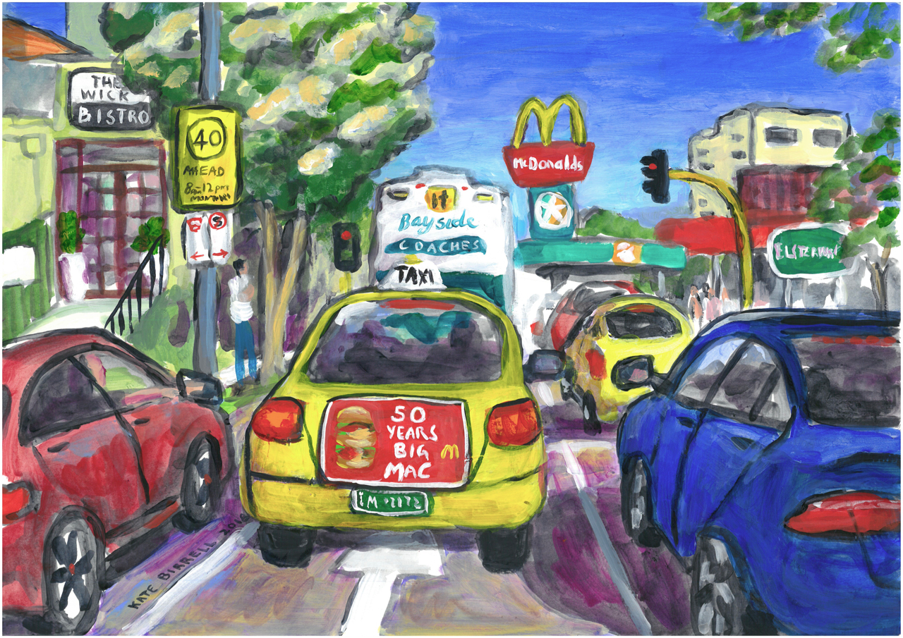 City Intersection with Traffic and a Macca's