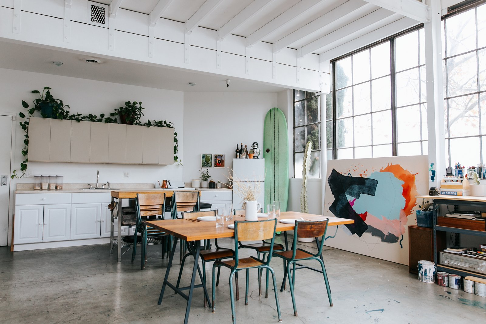 """""""The dining room table, the flat files bench, and the mobile shelving unit on the second floor were designed by Justin Godar specifically for the space. They all serve multiple purposes, and also marry form with function."""""""