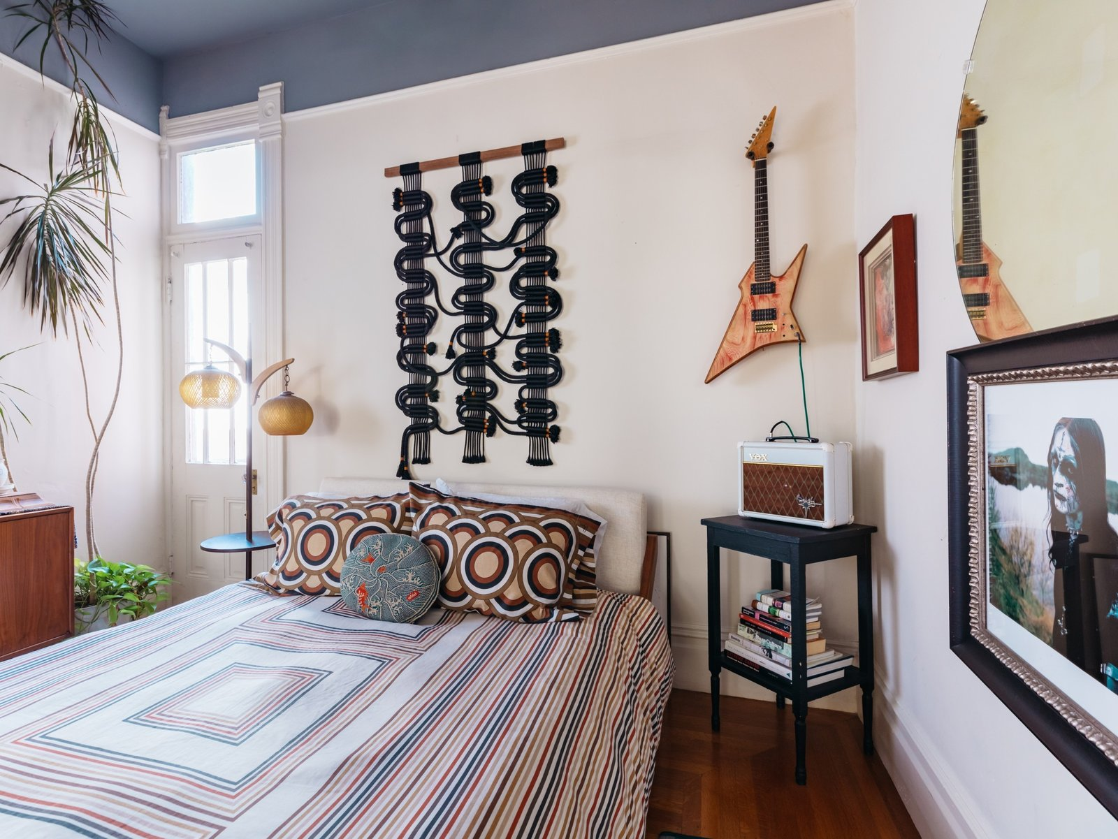"""The guest bedroom oozes retro vibes and features a """"circuit board"""" wall hanging by Windy. (Sothear Nuon)"""