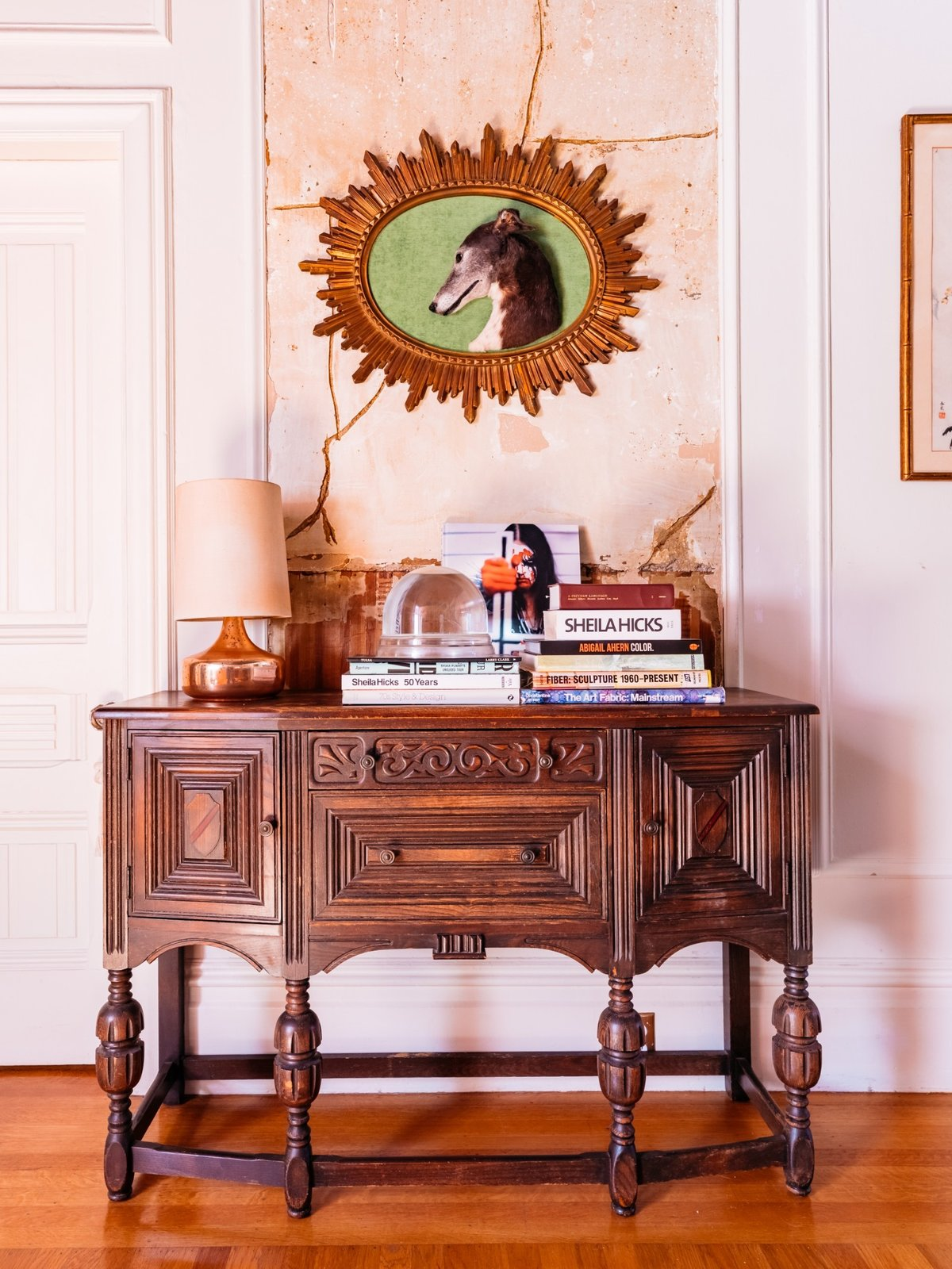 Windy's late dog, Thin Lizzie, is memorialized in her hallway over her grandmother's antique chest. (Sothear Nuon)