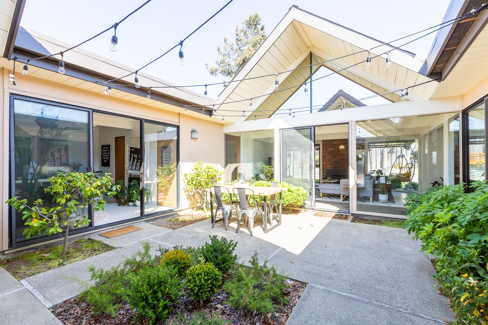 The atrium, one of the main distinguishing features of Eichler homes, connects the two A-frames. (Gillian Walsworth)