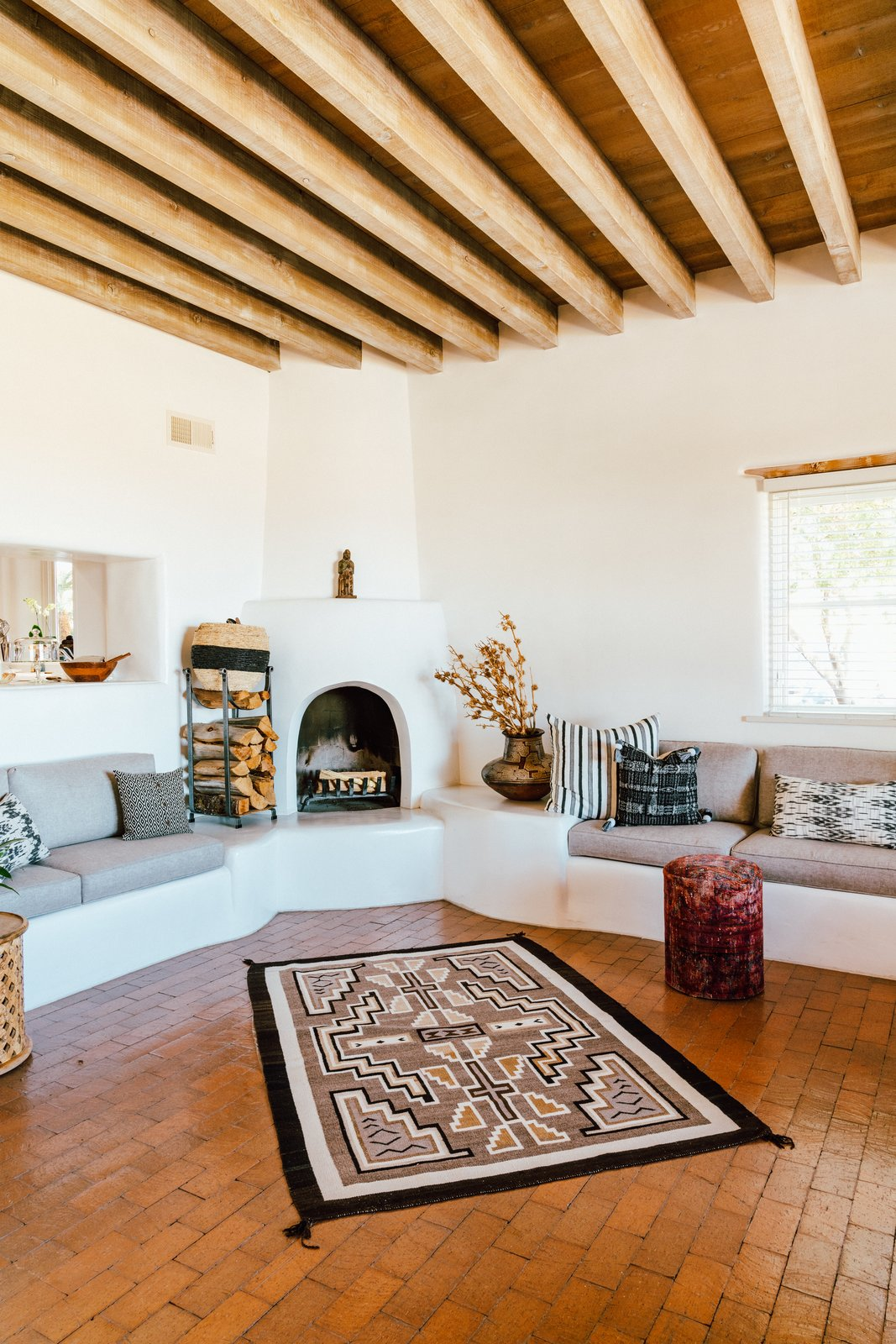 Three kiva fireplaces—and a large collection of rugs and textiles—offer warmth on cold desert nights. (Tim Melideo)