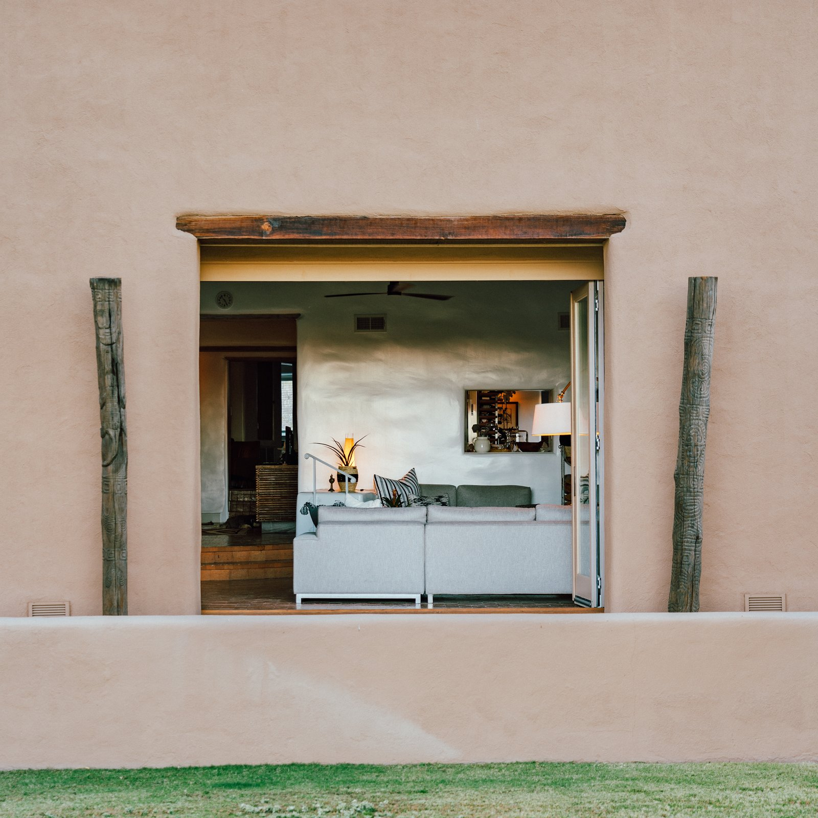 The 5,000-square-foot home has a main house with four bedrooms and three bathrooms, and a one-bed, one-bath casita. It's the epitome of a Santa Fe-style hacienda with a single story, endless loggias, and desert panoramas visible from every room. (Tim Melideo)