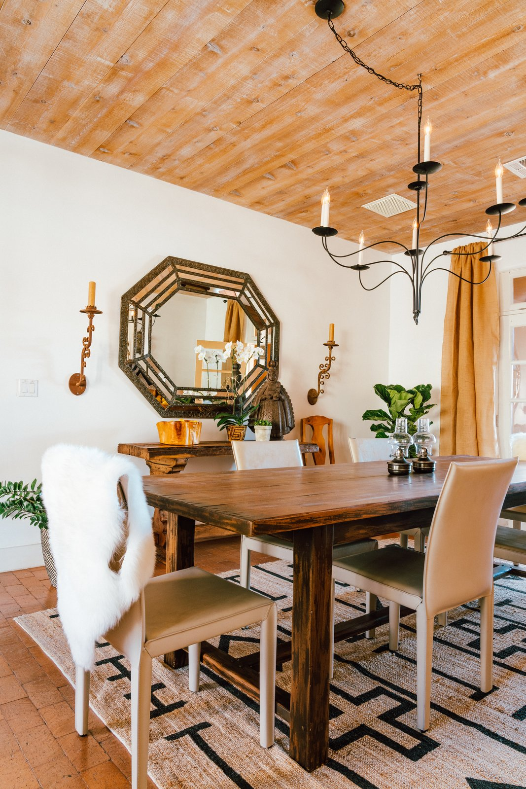 Young took cues from the home's architecture to refine the space while filling it with fresh decor. The floors are brick laid in sand, while large plank wood ceilings lie overhead. Adding to the neutral palette, the dining room is teeming with textures. (Tim Melideo)