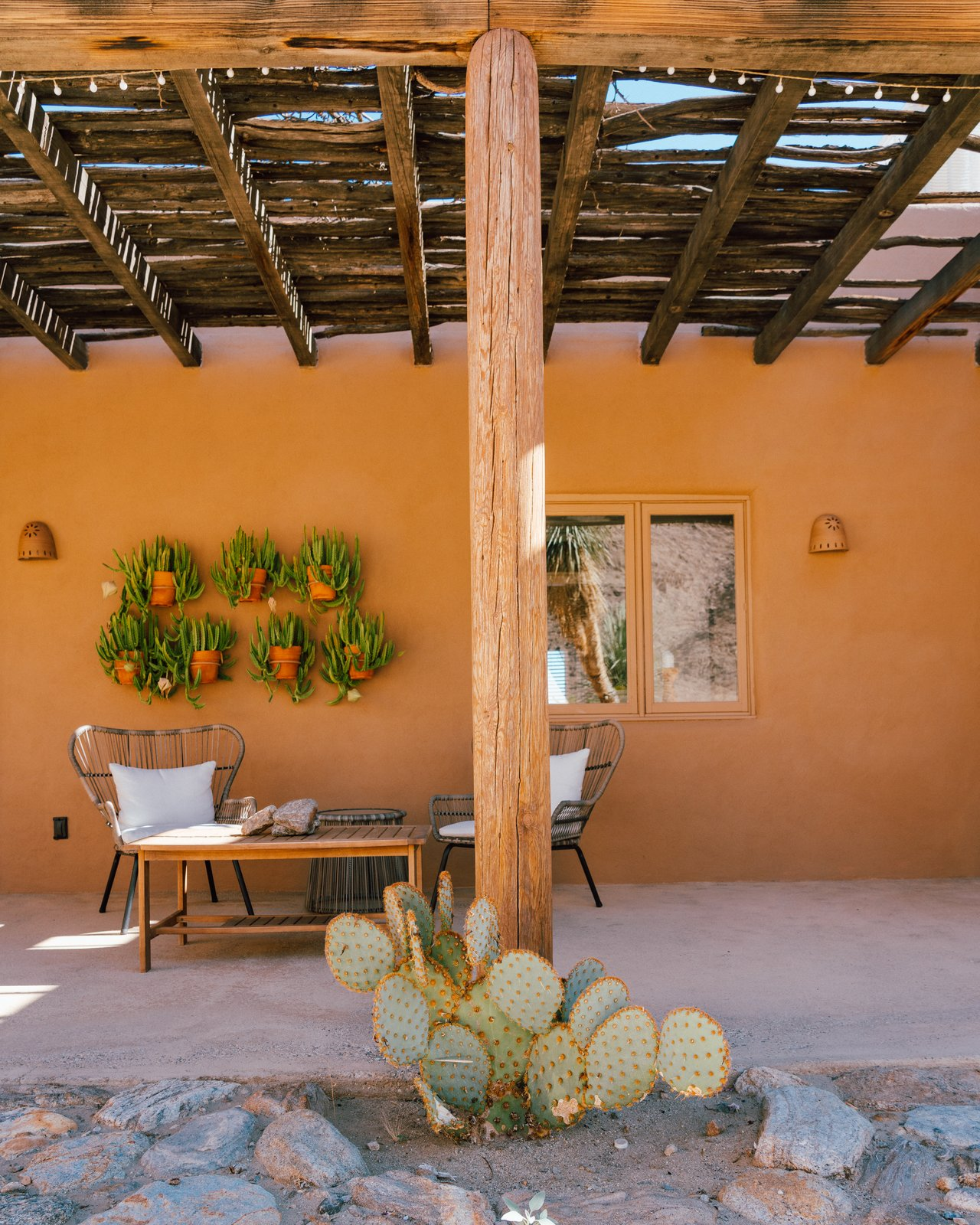 """""""The [exterior] house color had faded to pink by the time we bought it. We painted it a Sherwin Williams color called Jackson Tan, which melds into the colors of the desert."""" (Tim Melideo)"""