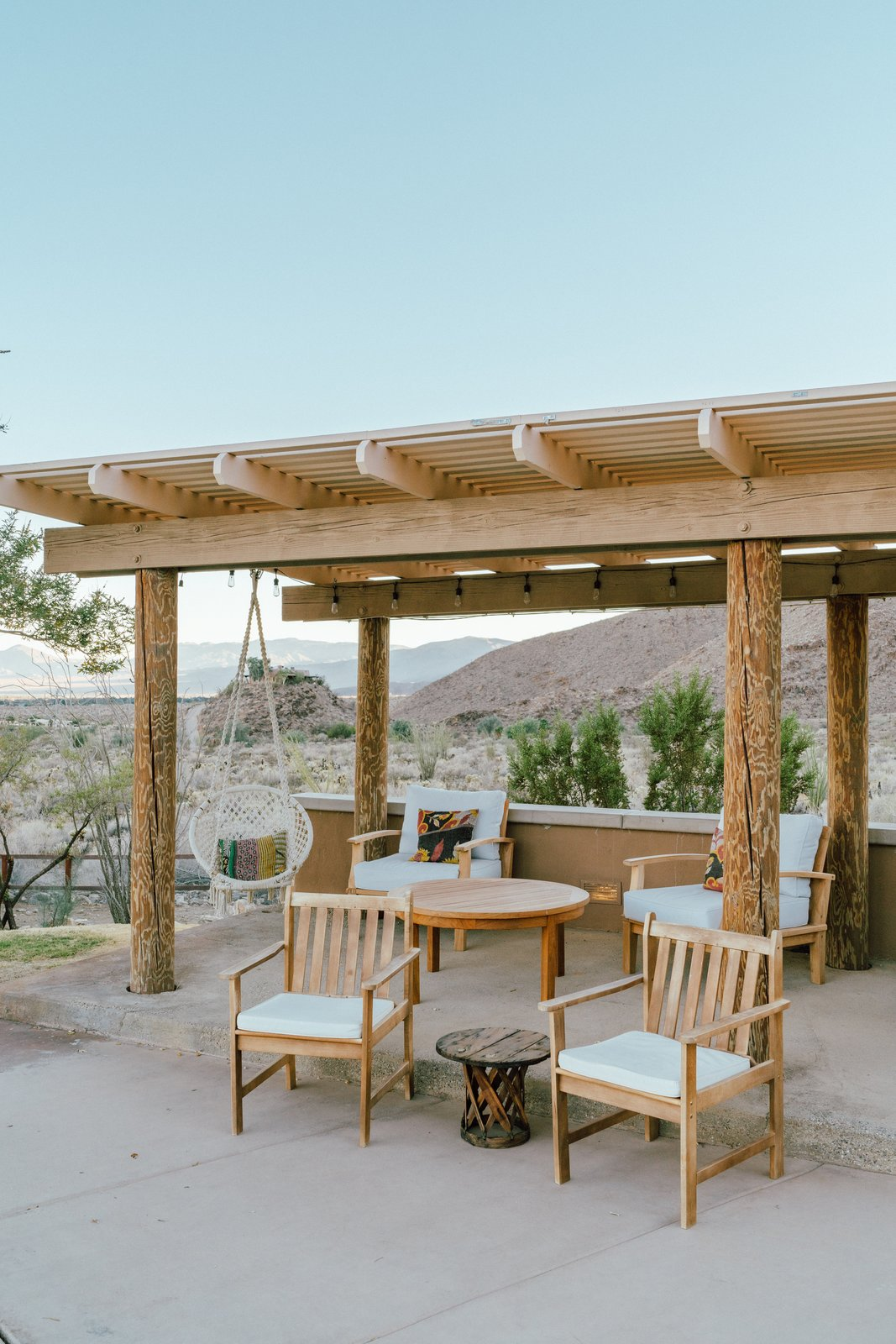 """""""The loggia poles around the hose at all patio areas were painted a dark green. We had them sanded to bring back their original rustic wood glory."""" (Tim Melideo)"""