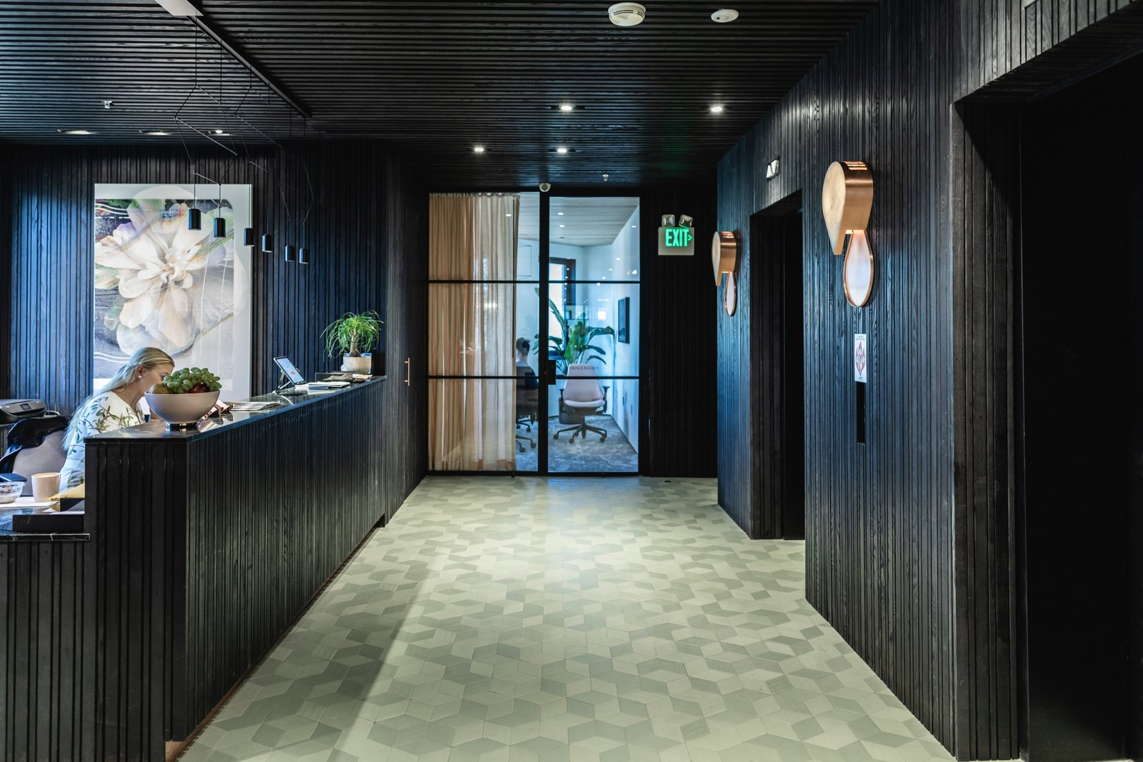 Textured black surfaces and exposed concrete pay homage to San Francisco's iconic Transamerica Pyramid, while Raw Edges for Mutina tiles break up the harsh lines with a muted color pop. (Sothear Nuon)