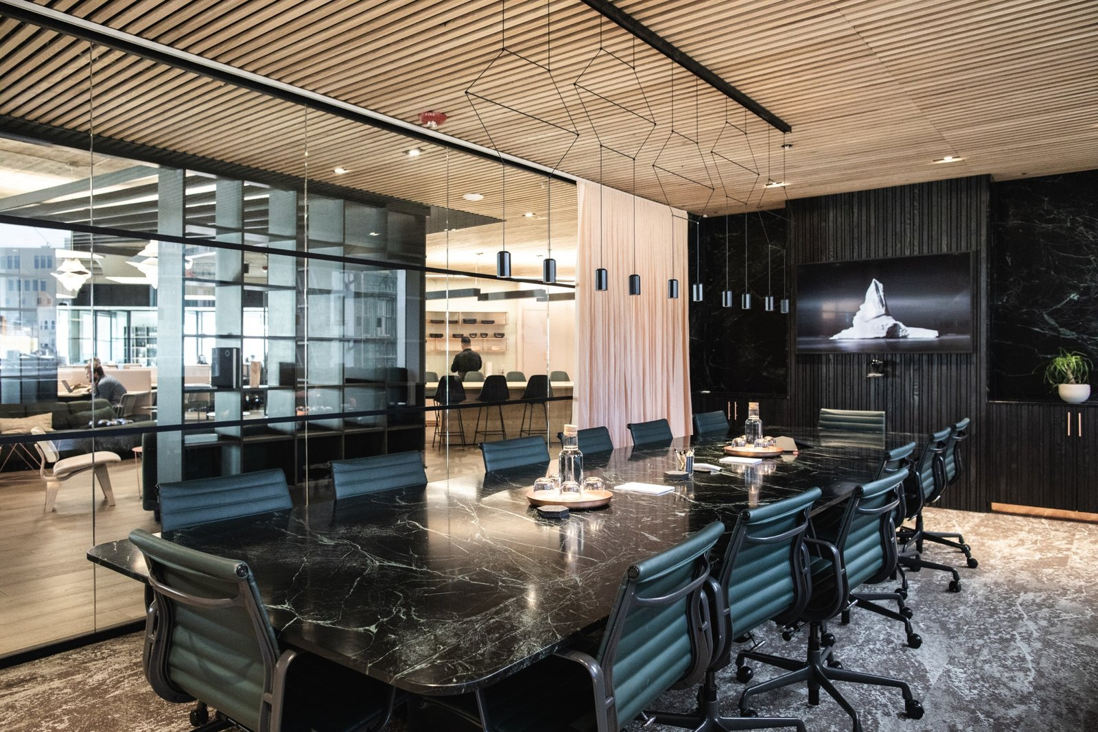 Custom-designed conference tables made of blackened ash and Verde Alpi green-and-black marble offer a dramatic space to brainstorm and collaborate. (Sothear Nuon)
