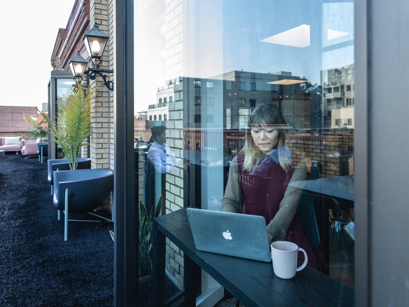 Jenny Xie, executive web editor, works in a phone booth overlooking the terrace. (Sothear Nuon)
