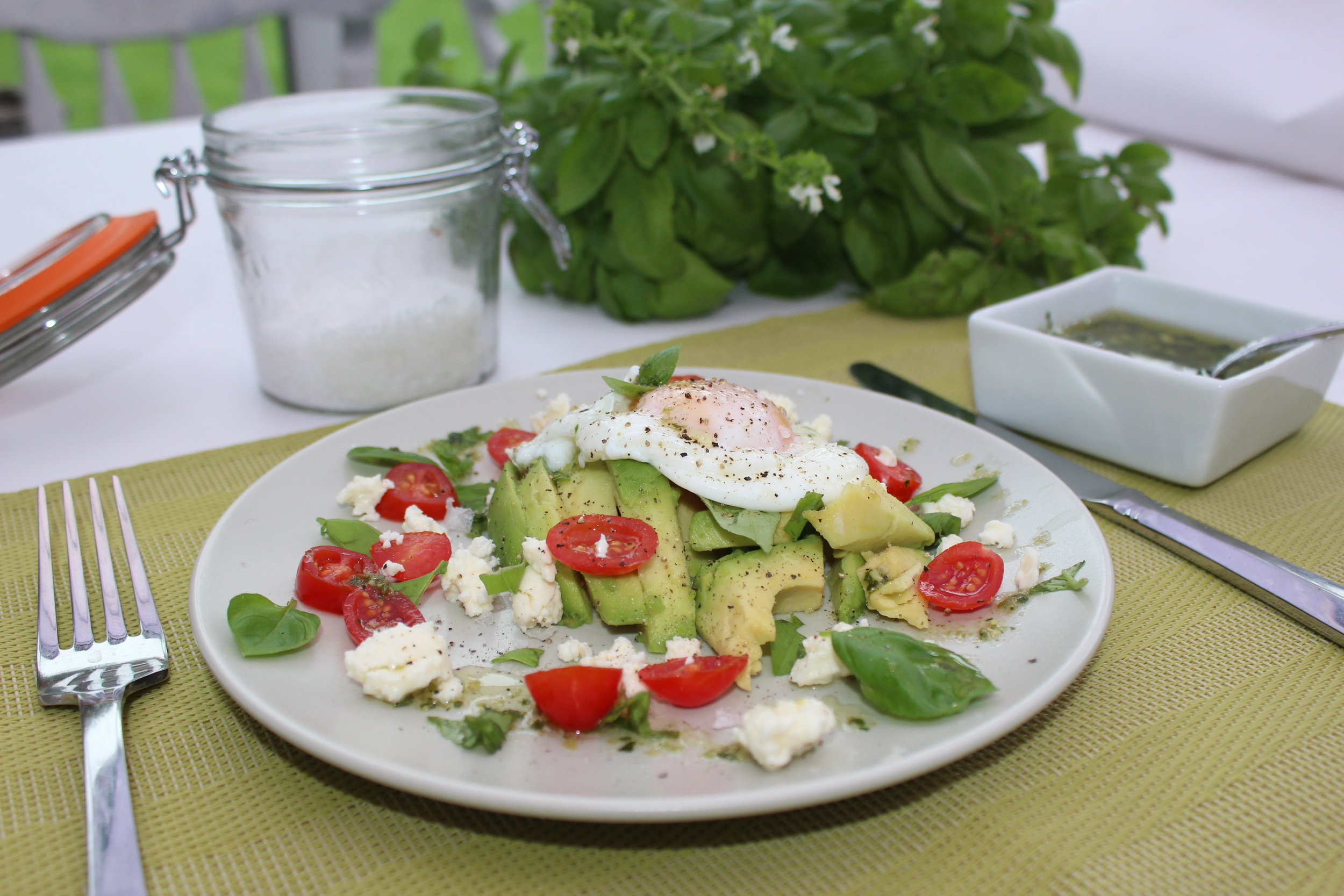 Poached egg on a bed of avocado - full of good fats!