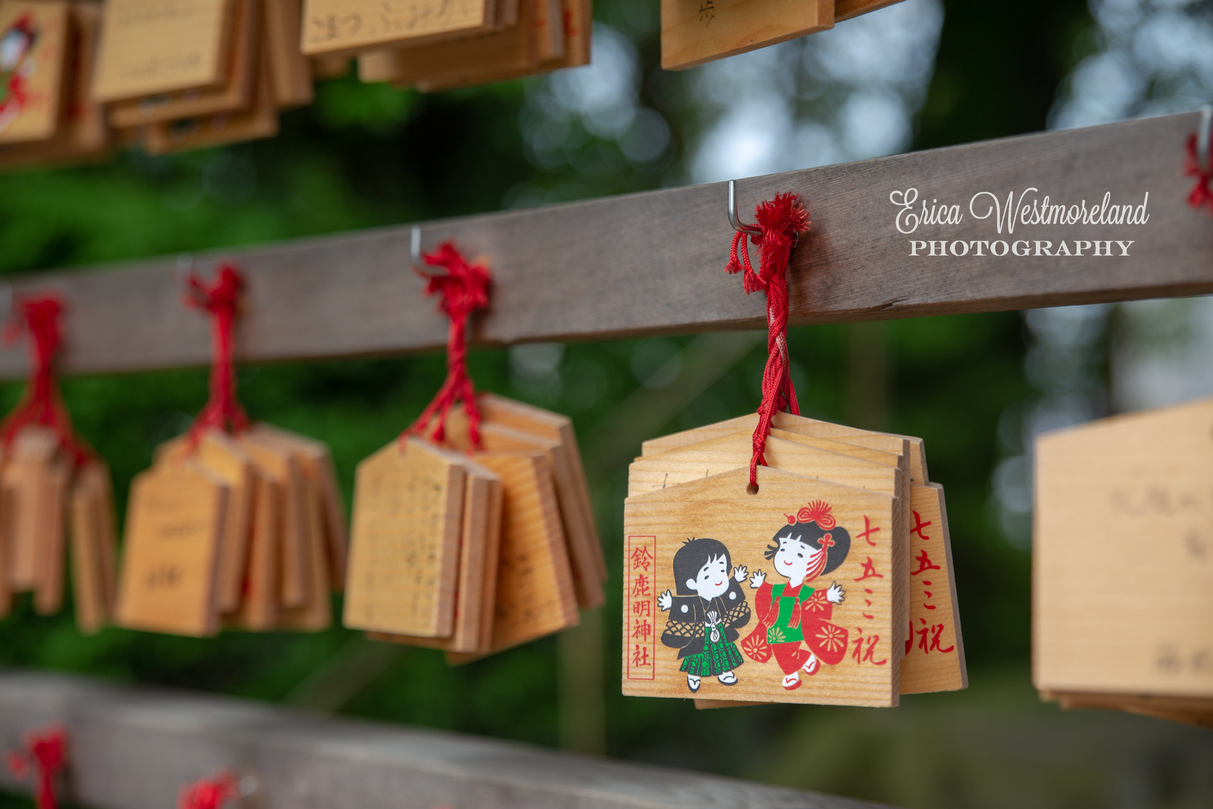 Ema (wooden plaques) are hung at Shinto shrines