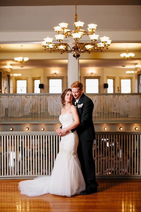 Photo of the bride and groom inside ballroom