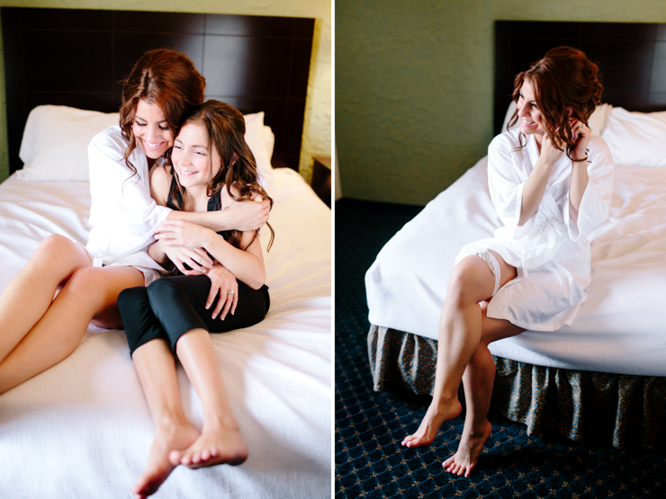 Bride and sister getting ready on wedding day in a hotel in bloomington, illinois