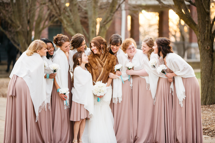 Bridesmaids laughing wearing pink long gowns