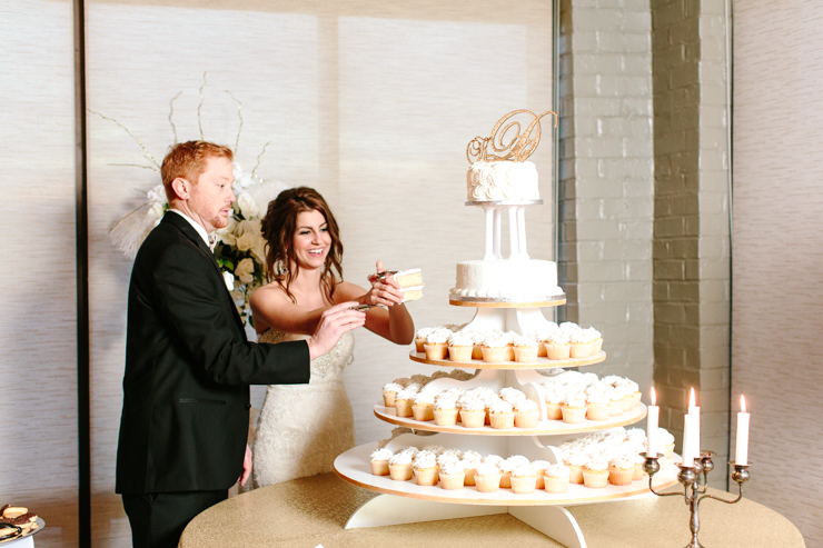 Bride and Groom cutting the cake at the reception