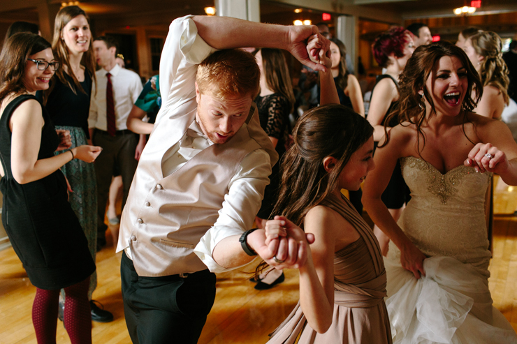 Groom dancing with his sister at wedding reception