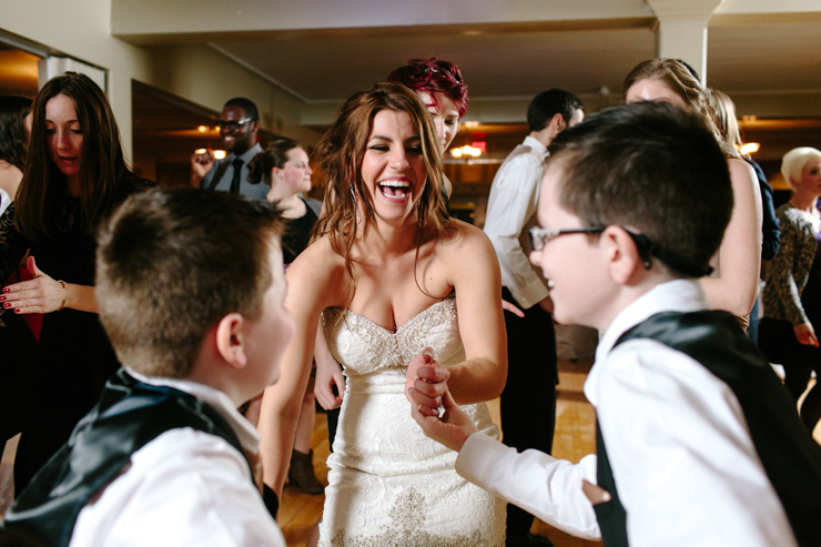 Bride dancing with her brothers at wedding reception