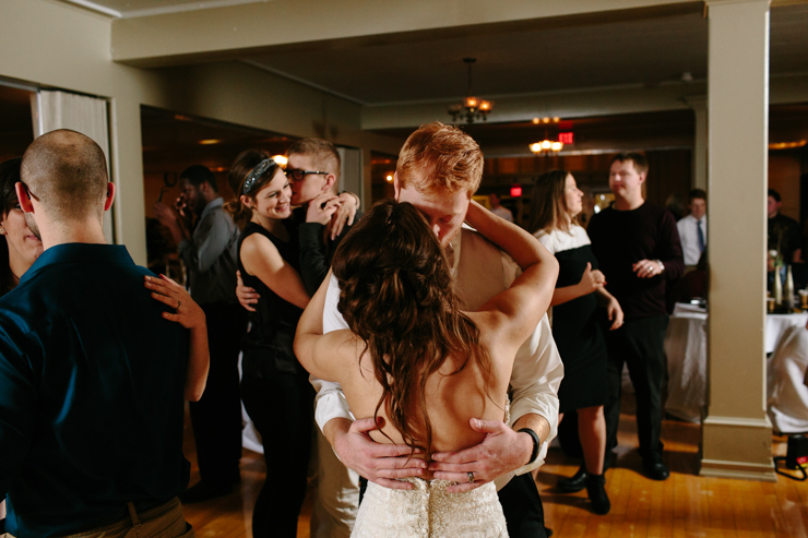 Bride and Groom Kissing and Dancing at the Reception