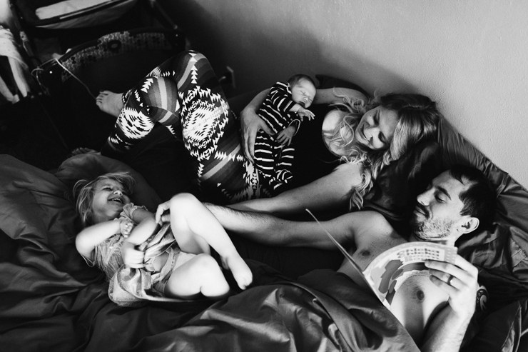 Family Snuggling in Bed