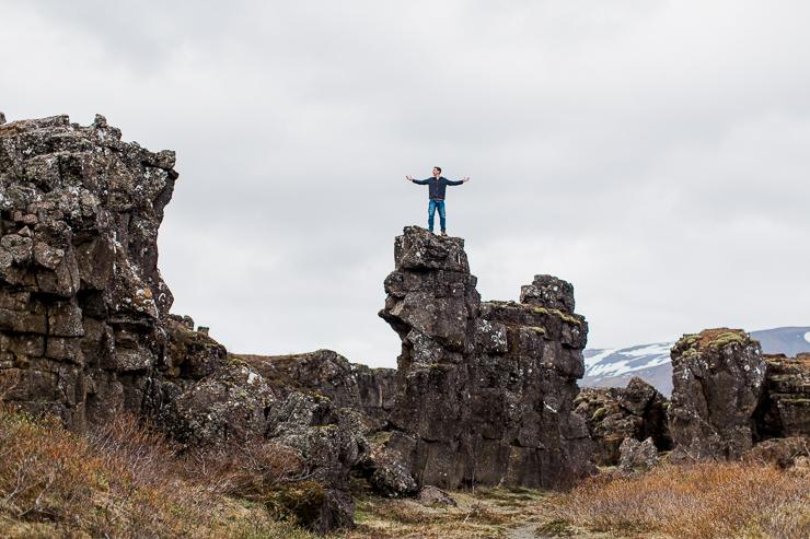 Man Climbing on rocks in Pingvellir National Park, Iceland